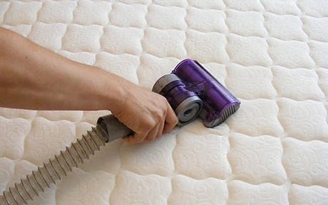 Mattress cleaning pre-vacuuming