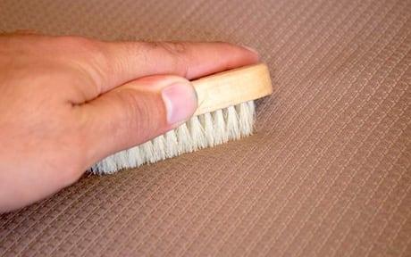 scrubbing sofa when cleaning